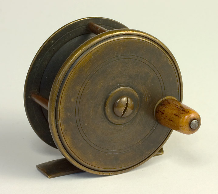 a solid brass fly reel that